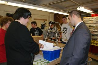 Junior Ricky Wecera reviews the design of the pyramid which is included in the 2013 FIRST Robotics Challenge with Legislator Calarco. Pictured, left to right: Ricky Wecera, Legislator Calarco.