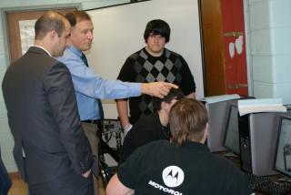 Mr. Ray explains the new computer program the Pat-Med Robotics Team is using for the 2013 season. Pictured, left to right: Legislator Calarco, Mr. Ray, Ricky Wecera, Tim Oliveira, Justin Ferrari